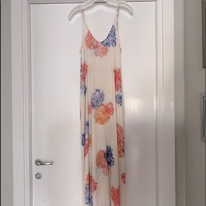 White floral maxi with adjustable straps. Size S/M
